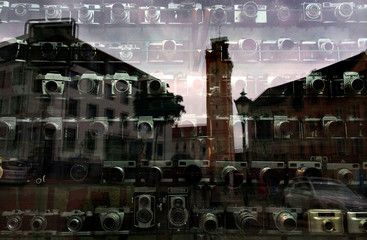 Vintage cameras are on decorative display in the shop window of a photo studio in Altenburg