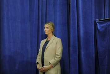 Ivanka Trump, daughter of U.S. Republican presidential candidate Donald Trump listens to her father at a campaign rally in Concord