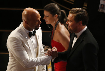 Leonardo Di Caprio speaks with Common before the show at the 88th Academy Awards in Hollywood