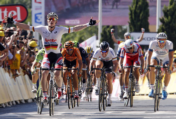 Lotto-Belisol team rider Andre Greipel of Germany celebrates as he wins the 176.5 km fifth stage of the centenary Tour de France cycling race from Aix-En-Provence to Montpellier