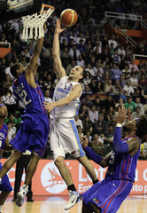 Argentina's Manu Ginobili goes to the basket under pressure from Dominican Republic's Michael Martinez and Sanchez during their quarterfinal round FIBA Americas Championship basketball game in Mar del Plata