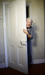 "British children's writer and illustrator Judith Kerr peers around a door as she recreates a scene from her bestselling picture book ""The Tiger Who Came To Tea"" , in London"