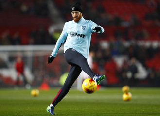 West Ham United's James Collins during the warm up before the game