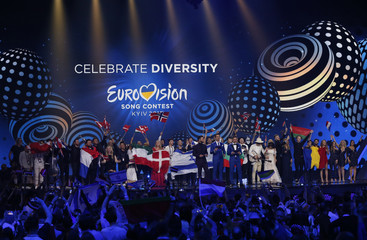 Finalists celebrate on the stage after the Eurovision Song Contest 2017 Semi-Final 2 at the International Exhibition Centre in Kiev
