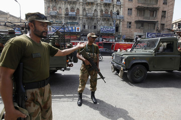 Paramilitary soldiers stand guard along a road outside the district city court in Karachi