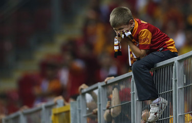 A young Galatasaray fan reacts during the Champions League Group H soccer match between Galatasaray and Braga at Turk Telekom Arena in Istanbul
