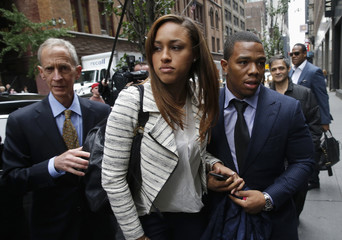 Former Baltimore Ravens NFL running back Ray Rice and his wife Janay arrive for a hearing at a New York City office building
