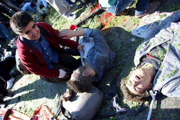 A man reacts as others lay on the ground after an explosion during a peace march in Ankara