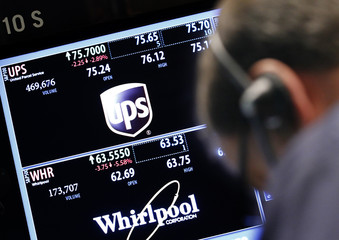A trader works at the post that trades UPS and Whirlpool on the floor of the New York Stock Exchange