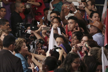 Brazil's President and PT presidential candidate Dilma Rousseff greets supporters during a campaign rally in Sao Paulo