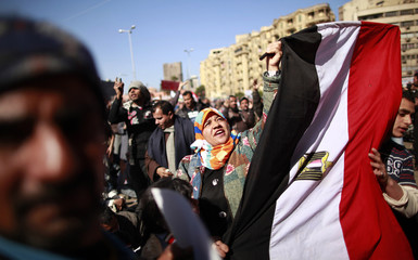 Demonstrators take part in a protest demanding the army to hand power to civilians, at Tahrir square in Cairo