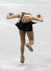 South Korea's Kim performs in women's short programme figure skating event at Vancouver 2010 Winter Olympics