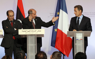 France's President Sarkozy with chairman of the Libyan National Transitional Council Jalil and the head of Libya's rebel National Transitional Council Jibril at the Elysee Palace in Paris