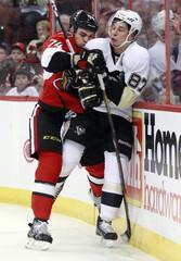 Ottawa Senators' Borowiecki hits Pittsburgh Penguins' Crosby during the first period of their NHL hockey game in Ottawa