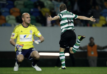 Sporting's Capel celebrates his goal against Feirense goalkeeper Paulo Lopes during their Portuguese premier league soccer match in Lisbon