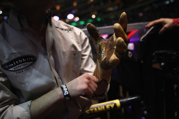A competitor puts on a glove before riding a bull during the Professional Bull Riders invitational at Madison Square Garden in New York