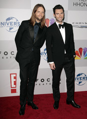 Maroon 5 band members James Valentine and Adam Levine arrive at the NBC Universal after party after the 69th annual Golden Globe Awards in Beverly Hills, California