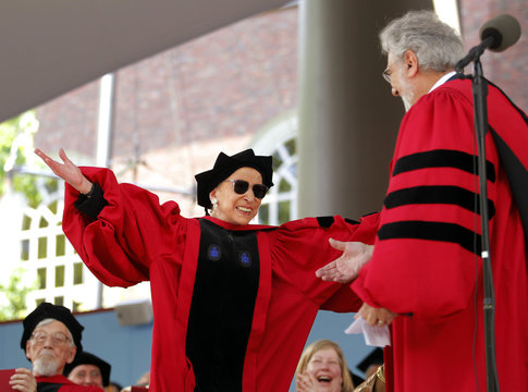 Supreme Court Justice Ruth Bader Ginsburg hugs tenor Placido Domingo during the 360th Commencement Exercises at Harvard University in Cambridge