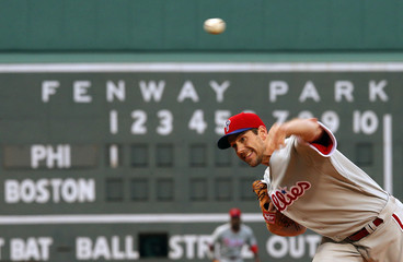 Philadelphia Phillies' Lee pitches against the Boston Red Sox in the first inning of their MLB interleague baseball game at Fenway Park in Boston