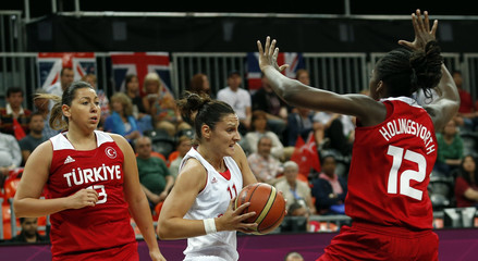 Croatia's Lelas is guarded by Turkey's Hollingsvorth and Horasan during their women's preliminary round Group A basketball match at the Basketball Arena during the London 2012 Olympic Games