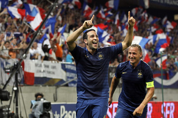 France's Rami and Mexes react after scoring the winning goal in their friendly soccer game against Iceland in Valenciennes