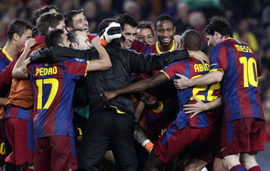 Barcelona's players celebrate qualifying for the final at the end of their Champions League semi-final second leg soccer match against Real Madrid in Barcelona