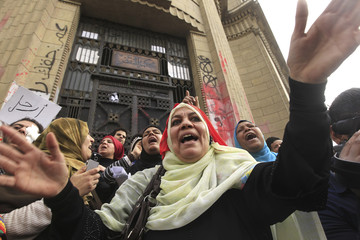 Protesters opposing Egyptian President Mursi shout in front of the courthouse and Office of the Attorney General during a protest near Tahrir Square in Cairo