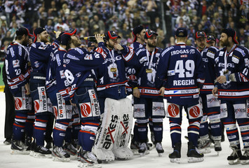 Players of new German champion Eisbaeren Berlin celebrate their victory against Adler Mannheim in Berlin