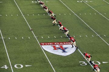Harvard University football team kicks off during their football game against Yale University at Harvard in Cambridge