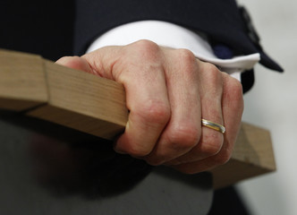 The hand with the wedding ring of Swiss National Bank is pictured during news conference in Bern