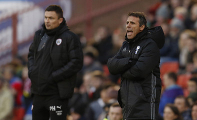 Birmingham City manager Gianfranco Zola (R) and Barnsley manager Paul Heckingbottom