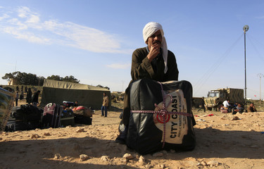 Egyptians waits for transportation at a refugee camp near the Libyan and Tunisian border crossing of Ras Jdir