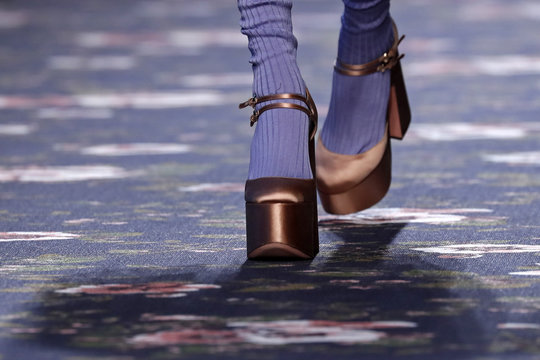 A model presents a shoes creation by Italian designer Alessandro Dell'Acqua as part of his Fall/Winter 2016/2017 women's ready-to-wear collection show for fashion house Rochas in Paris