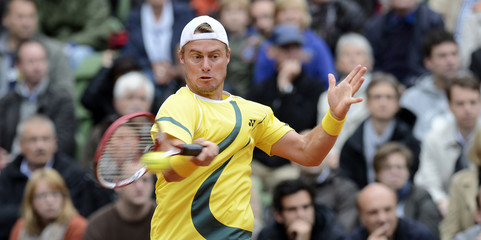 Australia's Hewitt returns a ball during his Davis Cup World Group play-off tennis double match with team mate Guccione against Germany's Becker and Petzschner in Hamburg