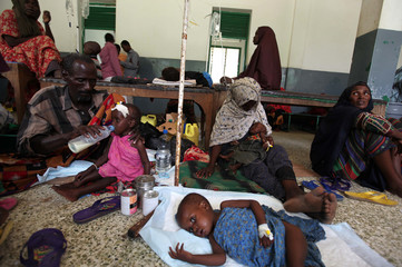 Internally displaced malnourished children receive treatment inside a paediatric ward at the Banadir hospital in Somalia