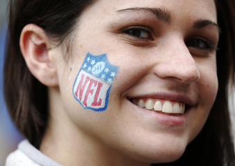 Mikaela Brady of Buffalo poses with NFL logo painted on her face during a 'block party' on London's Regent Street