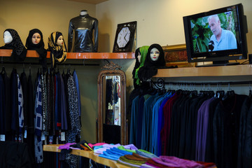 Headscarves decorate mannequin heads at Fayrouz Fashions, a boutique featuring traditional women's clothing from the Middle East, in Dearborn, Michigan