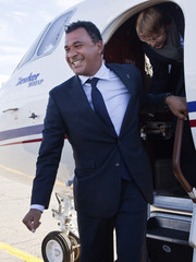 Dutch soccer legend Ruud Gullit steps off the plane after landing in the Chechen capital Grozny