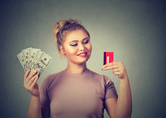 Woman with credit card and dollar cash happy with bank choice