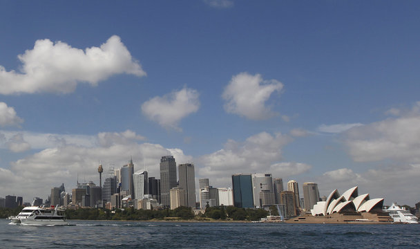 A catamaran leaves the central business district, with the Sydney Opera House seen in the background, in Sydney