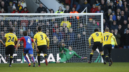 Watford's Troy Deeney scores their first goal from the penalty spot