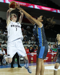 New Zealand's Edmondson goes for a basket against Argentina's Boquete during their women's FIBA Olympic Qualifying Tournament in Ankara