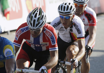 Last year's winner Hushovd of Norway cycles in front of Martin of Germany in a group that was distanced due to a crash, during the men's road race elite event at the UCI World cycling championships in Copenhagen