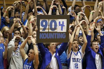 Duke University fans acknowledge Duke University head coach Krzyzewski's team's win over Davidson College during their NCAA basketball game in Durham