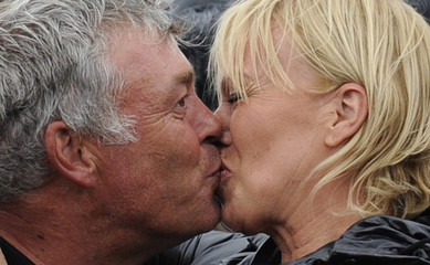 Darren Clarke of Northern Ireland kisses his partner Alison Campbell after winning the British Open golf championship at Royal St George's in Sandwich
