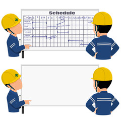 Two workers is discussing about work schedule