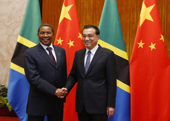 Tanzania's President Kikwete shakes hands with Chinese Premier Li before a meeting at the Great Hall of the People in Beijing