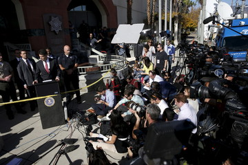 FBI Los Angeles Assistant Director in Charge David Bowdich speaks as San Bernardino Police Department Chief Jarrod Burguan looks on during a news conference about last week's shooting in San Bernardino