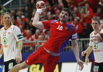 Russia's  Alexander Chernoivanov attempts to score next to Norway's Mamelund during their Men's European Handball Championship group A match in Graz