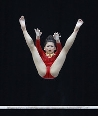 China's Jiang competes on the uneven bar at the qualifying round of the Gymnastics World Championships at the Ahoy Arena in Rotterdam